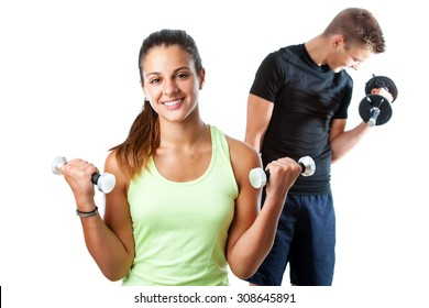 Close up portrait of attractive teen girl doing aerobic workout with boy in background. Isolated on white background.