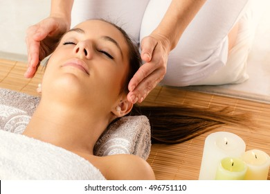 Close up portrait of attractive woman at alternative therapy session.