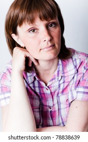 Close up portrait of an attractive woman in a plaid shirt