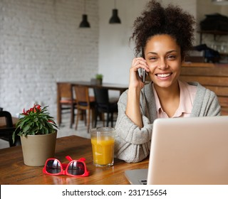 Close up portrait of an attractive you woman talking on phone at home
