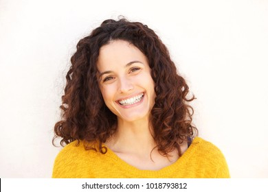 Close up portrait of attractive  young woman against white background smiling