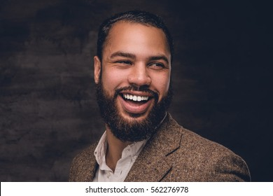 Close up portrait of bearded smiling black man in a wool suit.