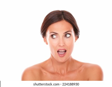 Close up portrait of beautiful adult woman for body care product looking to her right with nude shoulders on isolated white background - copyspace