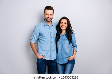 Close up portrait beautiful amazing cheer she her he him his couple lady guy friends stand close hands arms pockets wear casual jeans denim shirts outfit clothes isolated light grey background
