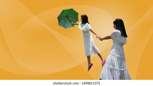 Close up Portrait beautiful  Asian girl attractive blackhair with white dress  so happy smiling and holding hand one girl. She flying with green umbrella and red shoes. Yellow Pastel Background. Copy