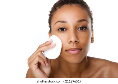 Close up portrait of a beautiful black woman removing make up