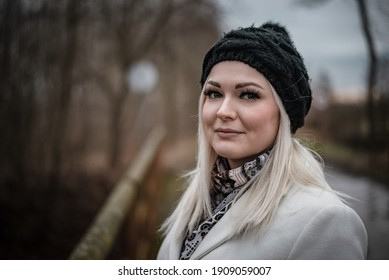 Close up portrait of beautiful blonde woman during winter walk out of town