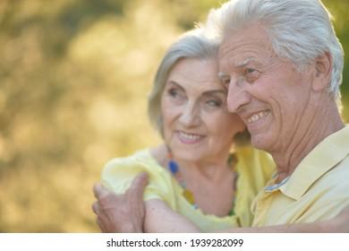 Close up portrait of beautiful caucasian senior couple hugging
