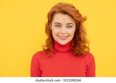 Close up Portrait of beautiful cheerful redhead girl curly hair smiling laughing looking at camera over yellow background