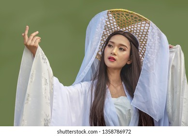 Close up portrait Beautiful Chinese woman white dress traditional isolated on green background,