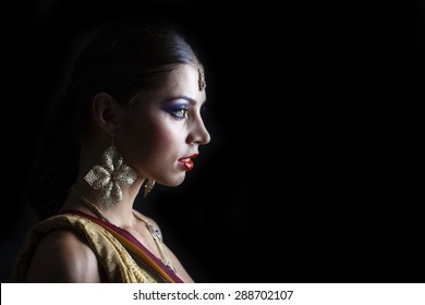 Close up portrait of beautiful eastern woman on a black background