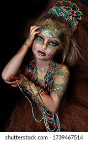 close up portrait of beautiful ethnic colorful girl with big crown of beads. professional creative  makeup. face painting