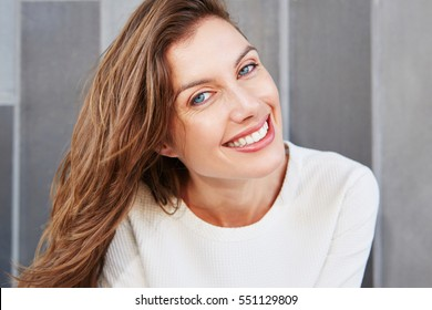 Close up portrait of beautiful face of young smiling woman