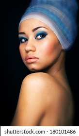 Close up portrait of a beautiful female fashion model with  turban on the head .Portrait of an African American Black Woman.Beauty.Space