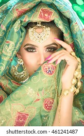 Close up portrait of a beautiful female model in makeup and jewellery