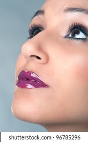 Close up portrait of beautiful girl with bright red glossy lips.
