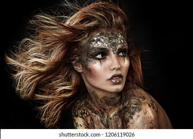 close up portrait of beautiful girl with Halloween makeup. professional face painting