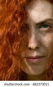 Close up portrait of a beautiful girl with long red hair
