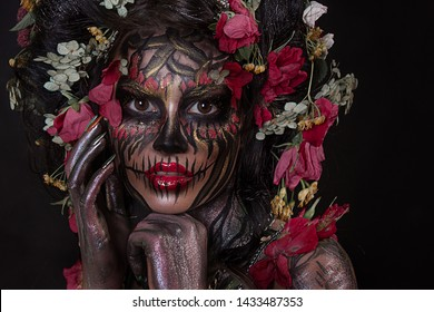 close up portrait of beautiful girl with skull makeup. professional Halloween  face painting with flower crown on head