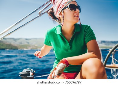 Close up portrait beautiful girl thinking , yachting, Croatia yachting sport, woman on deck, casual yachting wear, yacht in the sea, summer travel, daylight, tan, pretty,attractive, girl in sunglasses
