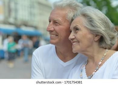 Close up portrait of beautiful happy mature couple traveling