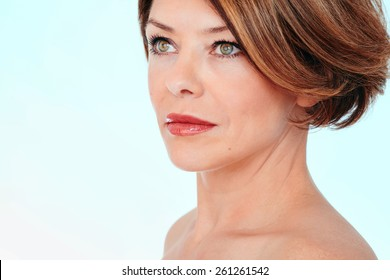 Close up portrait of beautiful middle aged woman looking aside