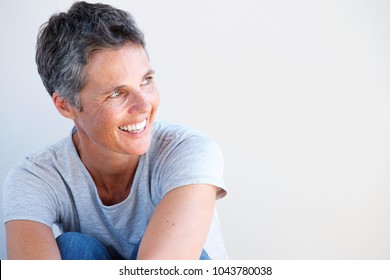 Close up portrait of beautiful older woman smiling against white background