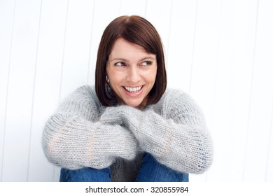 Close up portrait of a beautiful older woman smiling against white background