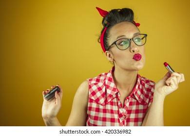 Close up portrait beautiful pin up girl putting on makeup, isolated yellow background