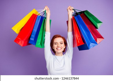 Close up portrait of beautiful pretty cheer she her girl going home after shopping glad with new stuff hands raised above head black friday isolated on violet background