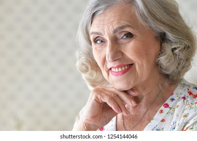 Close up portrait of beautiful senior woman at home