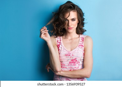 Close up portrait of a beautiful woman. Lady on a blue background.