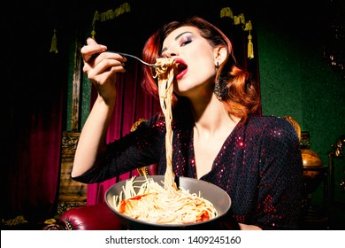 A close up portrait of a beautiful woman posing in the vintage interior and having a meal. Beauty, fashion, interior.