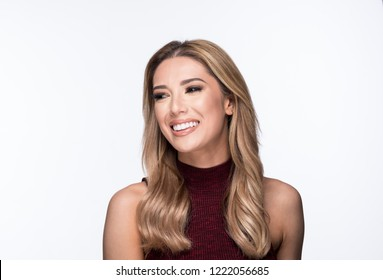 Close up Portrait of a Beautiful Woman Smiling in a Off Shoulder Turtle Neck Shirt