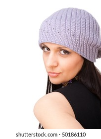 Close up portrait of a beautiful woman in winter cap, on a white background with copyspace.