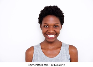 Close up portrait of beautiful young african woman with big smile on white background