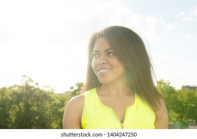 Close up portrait of a beautiful young african american woman smiling and looking up.