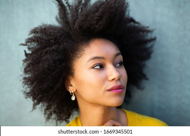 Close up portrait beautiful young african american woman with afro hair looking away