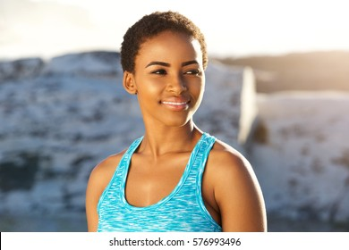 Close up portrait of beautiful young black sports woman smiling