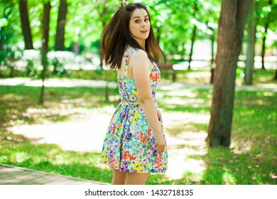 Close up portrait of beautiful young happy brunette woman sexy dress, summer park outdoors