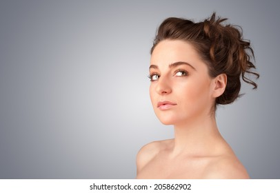 Close up portrait of beautiful young naked girl on gradient background