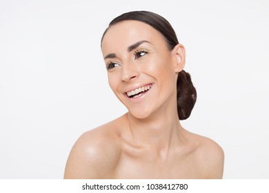 Close up Portrait of Beautiful Young Woman with Clean Fresh Skin. Face care. Facial treatment. Cosmetology Concept. Beauty and spa