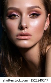 Close up portrait of beautiful young woman with professional makeup, perfect skin, colorful eyeshadows.