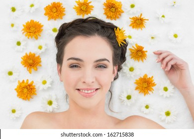 Close up portrait of a beautiful young woman with flowers in beauty salon