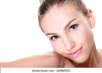 Close up portrait of beautiful young woman face while lying. Isolated on white background. Skin care or spa concept