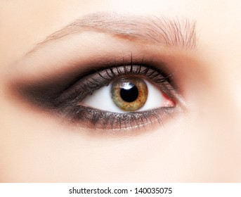 close up portrait of beautiful young woman's eye zone make up