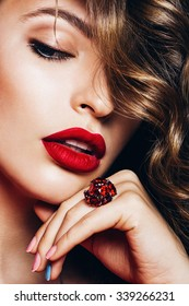 close up portrait of blond woman with ruby lips and ring