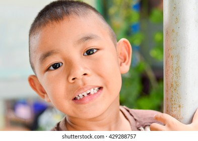 Close up portrait of boy laughing looking at camera portrait.Close up face with smiling kid.