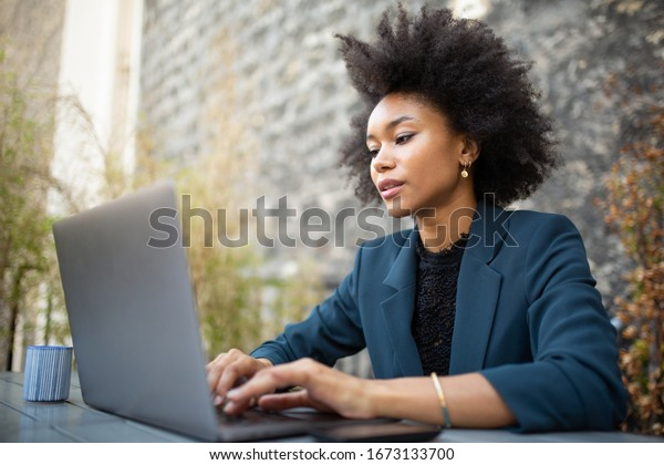 Close up portrait businesswoman sitting with laptop computer at table