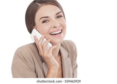 close up portrait of businesswoman talking on her mobilephone isolated on white background